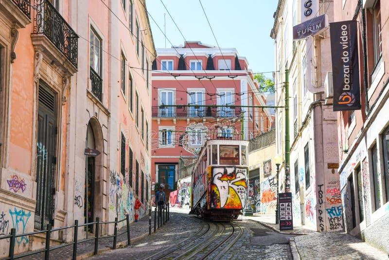 Elevador da Gloria in Lisbon. Colorful Elevador da Gloria going through narrow streets in Lisbon. Europe. Elevador da Gloria is a very old public transport royalty free stock images