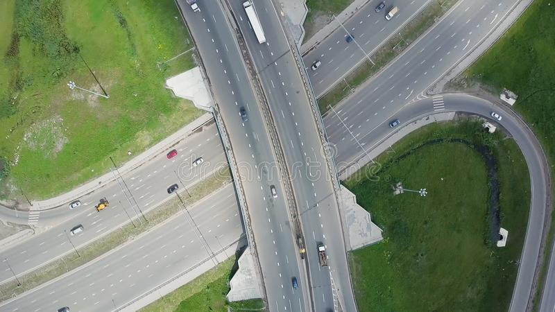 Elevated expressway. Clip. Top view at curves and lines of city highway. The curve of suspension bridge. Background royalty free stock photography