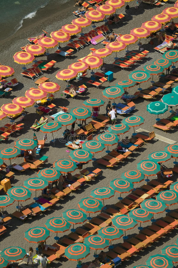 Elevated pattern view of famous beach umbrellas of Amalfi, a town in the province of Salerno, in the region of Campania, Italy, on stock photo