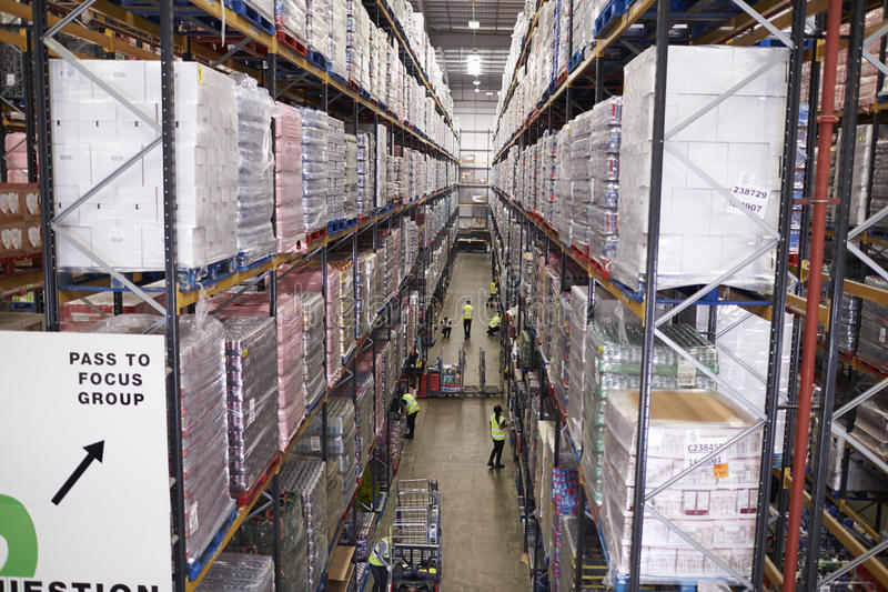 Elevated view of aisle between storage units in a warehouse royalty free stock image