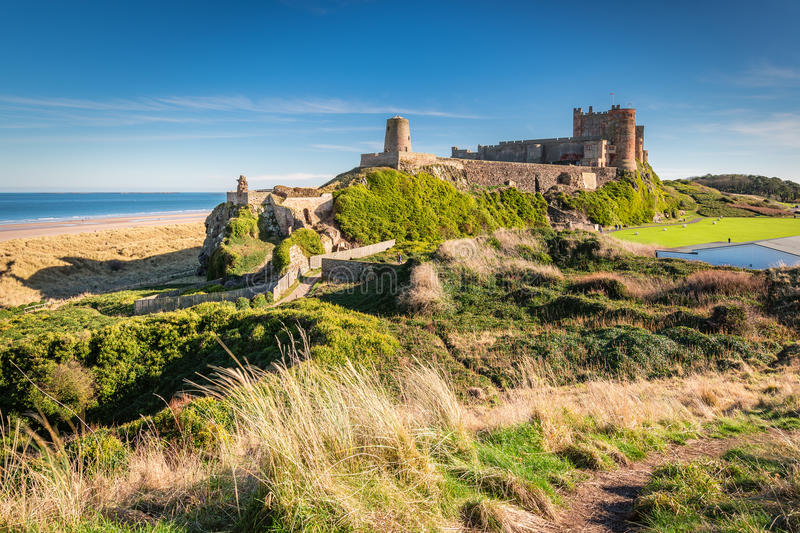 Elevated View of Bamburgh Castle. Bamburgh Castle viewed from an elevated hillock, on the Northumberland coastline royalty free stock images