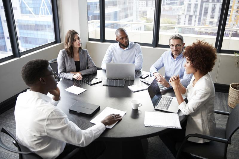 Elevated view of corporate business colleagues talking in a meeting room royalty free stock photos