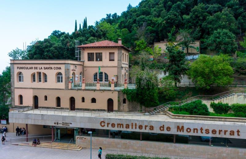 Elevated view of funicular De La Santa Cove and Cremallera rack railway train stations at Santa Maria de Montserrat abbey stock photos