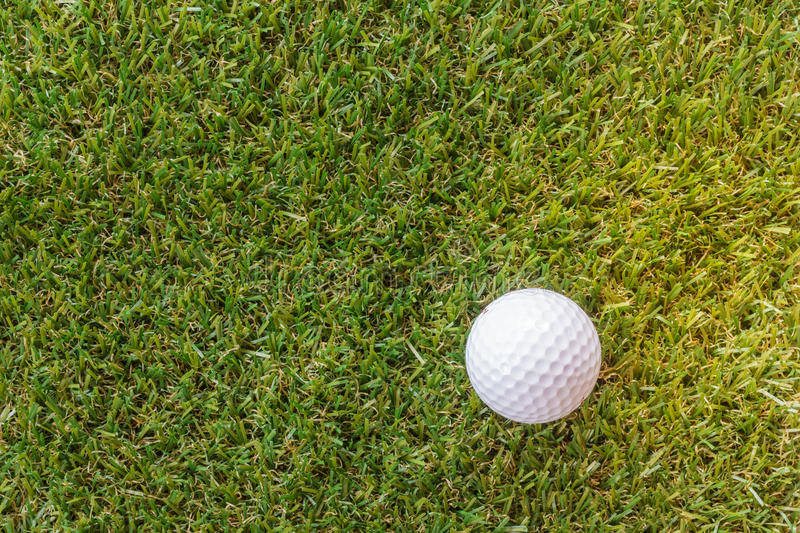 Elevated view of golf ball on grass. Individual sports stock photography