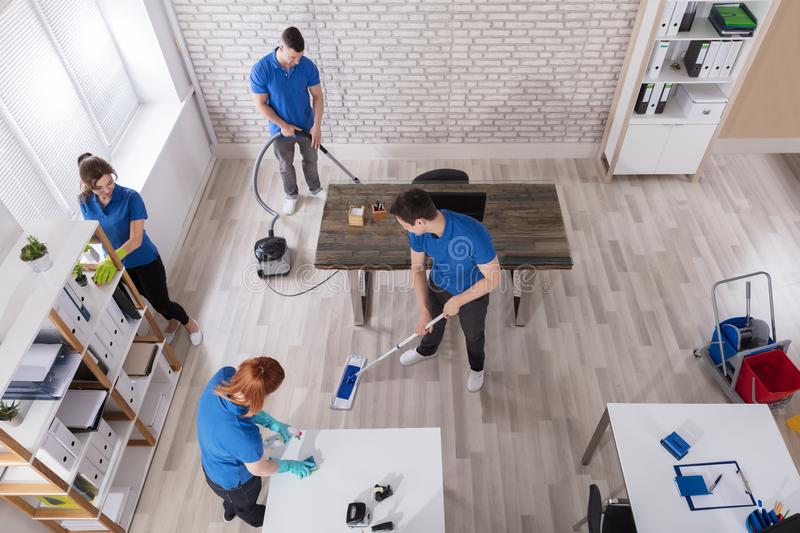 Elevated View Of Janitors Cleaning The Office stock photography