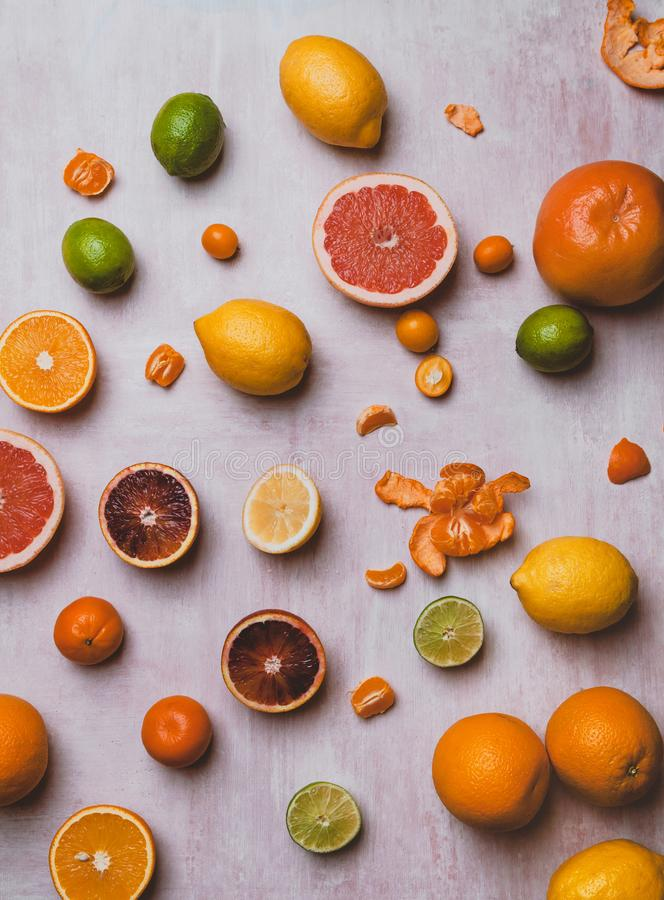 elevated view of limes, grapefruit, lemons, oranges, blood oranges, tangerines and kumquats stock photos