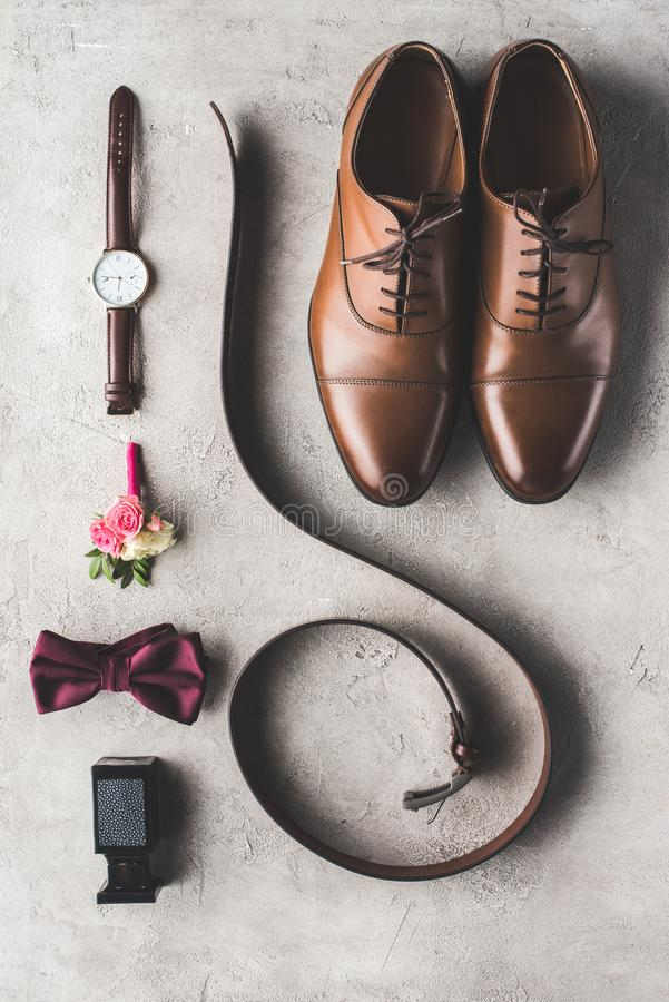 elevated view of male wedding accessories for groom stock images