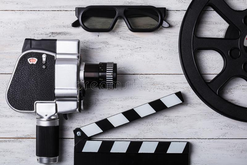 Elevated View Of Movie Camera, Film Reel And Clapper Board stock photos