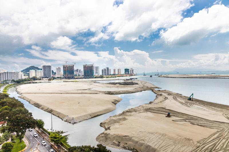 Elevated view of Penang`s Gurney Drive sea reclamation. Project royalty free stock photo