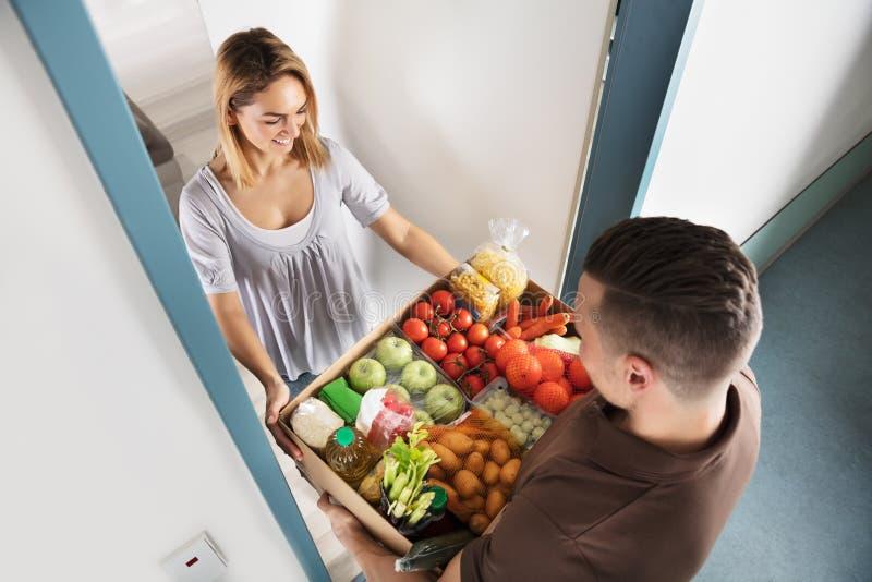 Man Delivering Groceries stock images