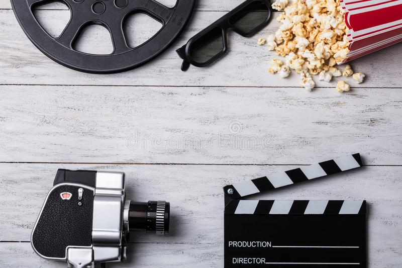 Spilled Popcorn With Clapperboard And Movie Camera stock photo
