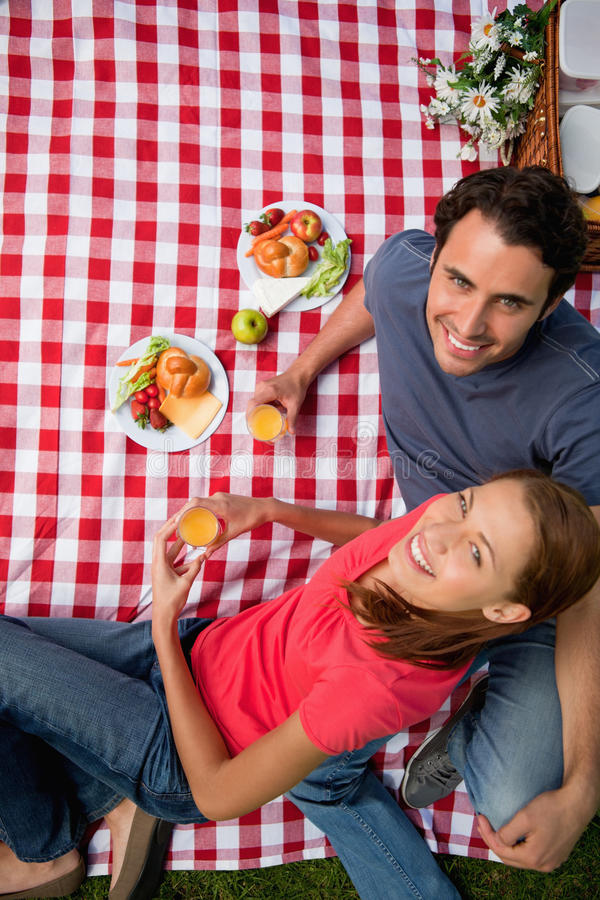 Download Elevated View Of Two Smiling Friends As They Lie On A Blanket Wi Stock Image - Image: 25332241