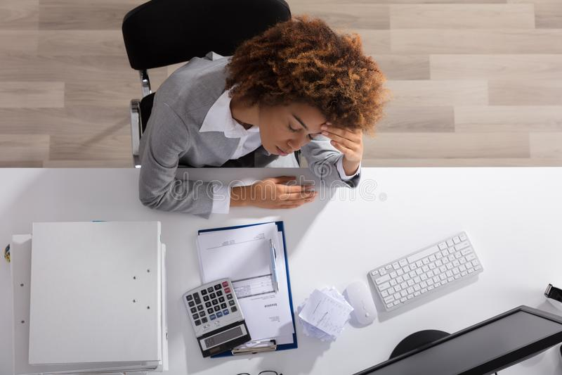 Unhappy Afro American Businesswoman Sitting In Office royalty free stock image