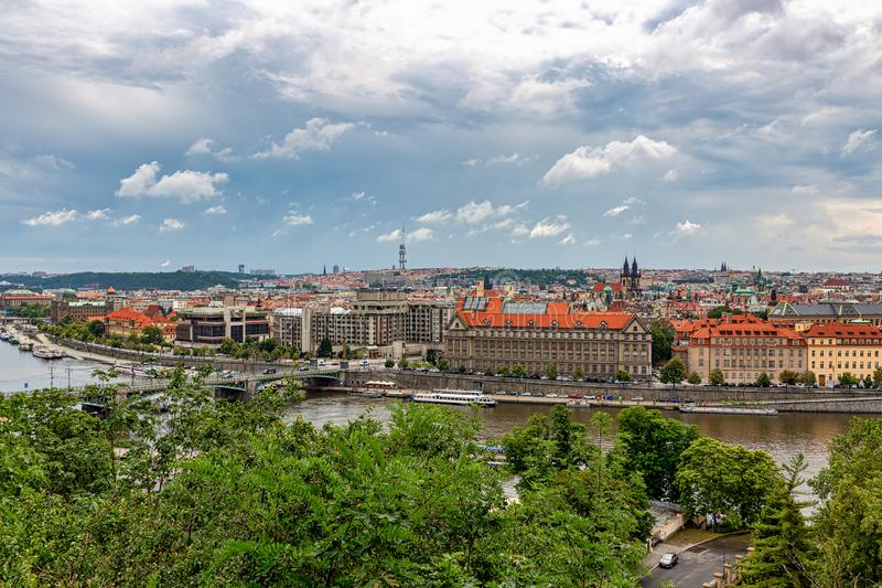 Elevated view of the Vltava River and the skyline of Prague, Czech Republic. Skyline of Prague, Czech Republic after a brief summer cloudburst with the Vltava royalty free stock photos