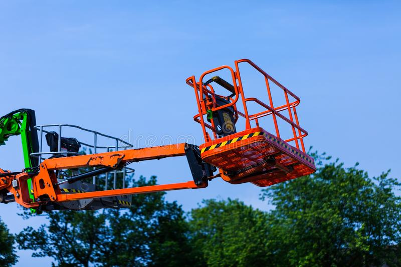 Elevating crane basket for engeneer. Industry concept with construction site elevating crane. Elevating crane basket for engeneer. Industry concept with royalty free stock images