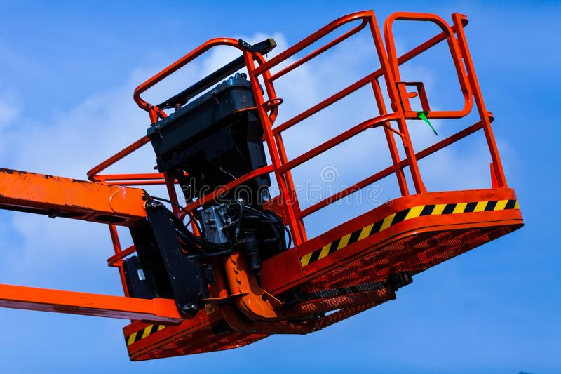Elevating crane basket for engeneer. Industry concept with construction site elevating crane. Elevating crane basket for engeneer. Industry concept with royalty free stock photos