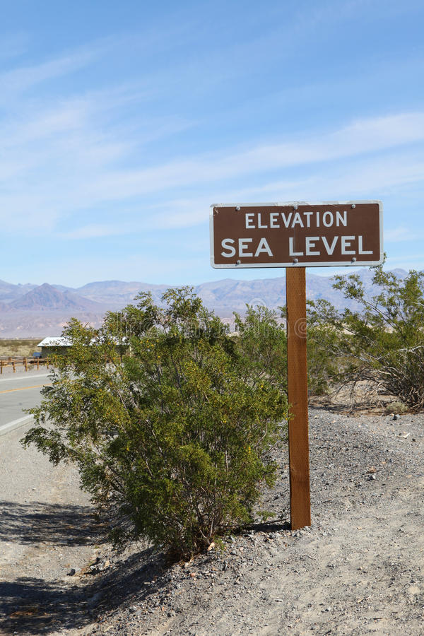 Elevation Sea Level Sign. An elevation sea level sign on the road stock photography
