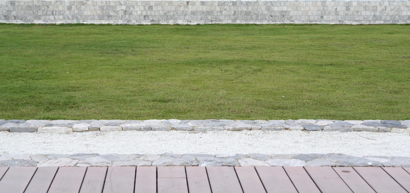 Download Elevation Of The Timber Terrace, Green Grass Lawn And Low Height  Stock Image