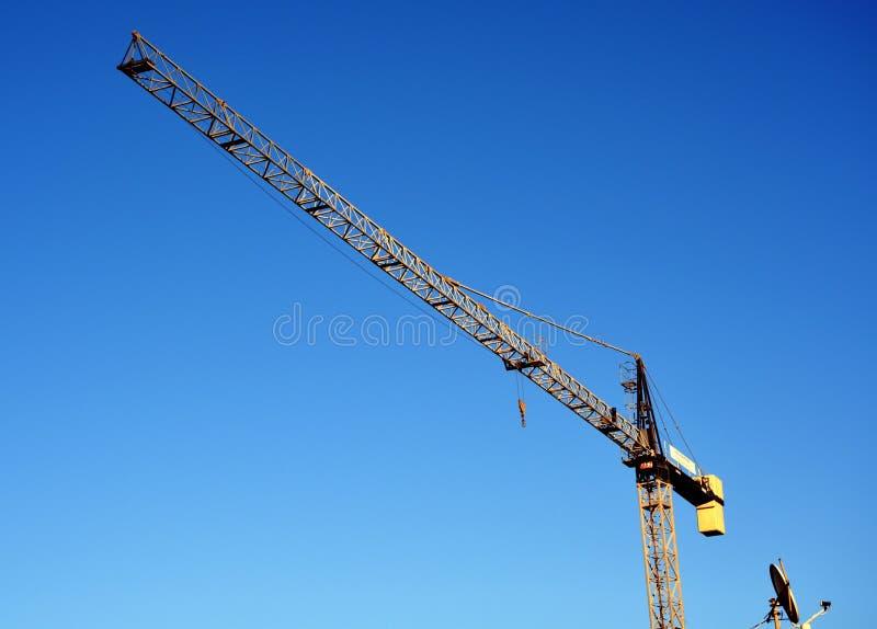 Crane on blue sky stock photo