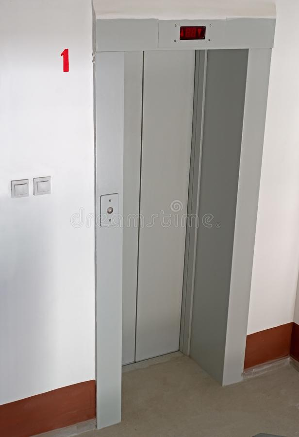 Elevator door in entrance hall of an apartment building royalty free stock photo