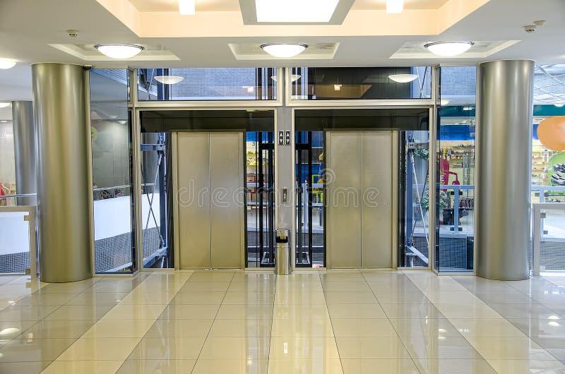 Elevator. Door glass or elevator in shoping centre stock photo