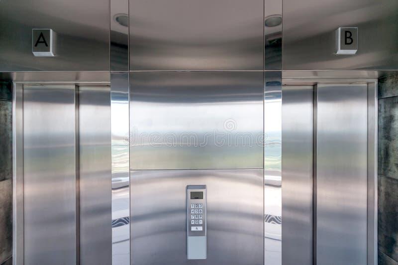 Elevator doors. Stainless steel modern elevator doors royalty free stock image