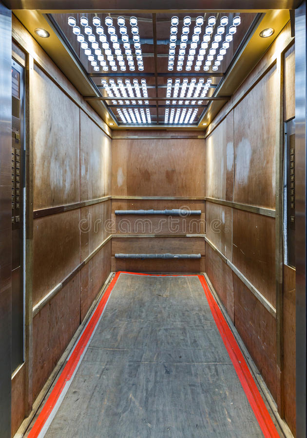 Elevator lined inside with plywood to prevent scratches stock photos