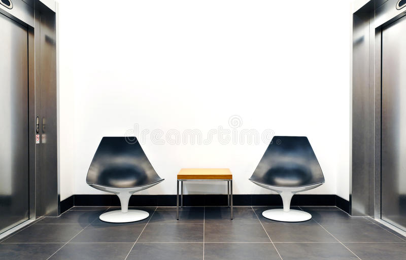 Elevator lounge. With a white copy space wall royalty free stock photography