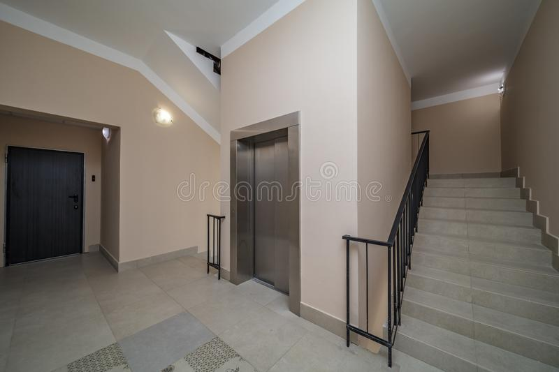Elevator and stairs. Up and down in a modern elegant building royalty free stock image