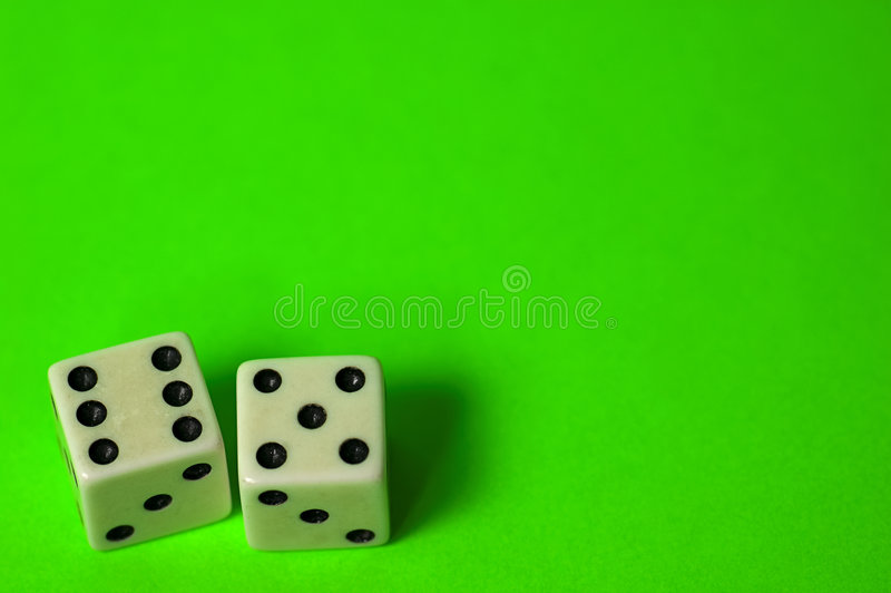 Eleven. Photo of Dice on Green Background. Room For Copy - Part of Series stock image