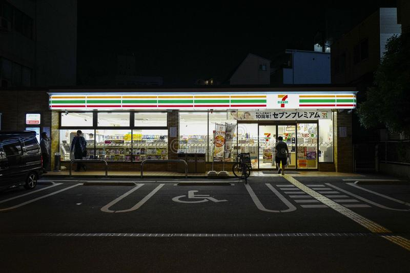 The 7-eleven convenience stores at night time. 7-Eleven Inc. is a Japanese-owned American international chain of convenience store stock photography