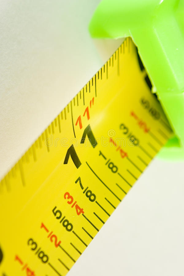 Eleven Inches. Close up of yellow tape measure showing eleven inches stock photo
