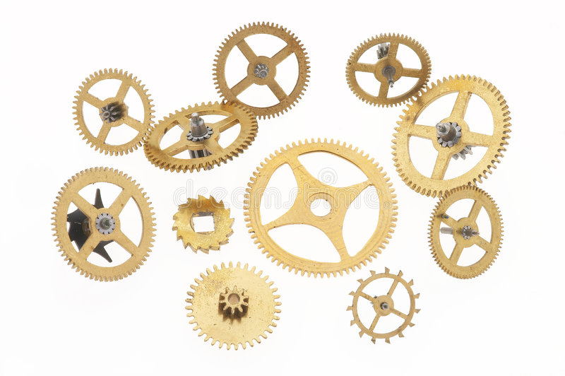 Eleven old little cogwheels. Many old gold-coloured little cogwheels and some are connected stock image