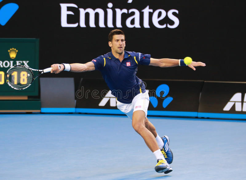 Eleven times Grand Slam champion Novak Djokovic of Serbia in action during his Australian Open 2016 quarterfinal match. MELBOURNE, AUSTRALIA - JANUARY 26 2016 royalty free stock image