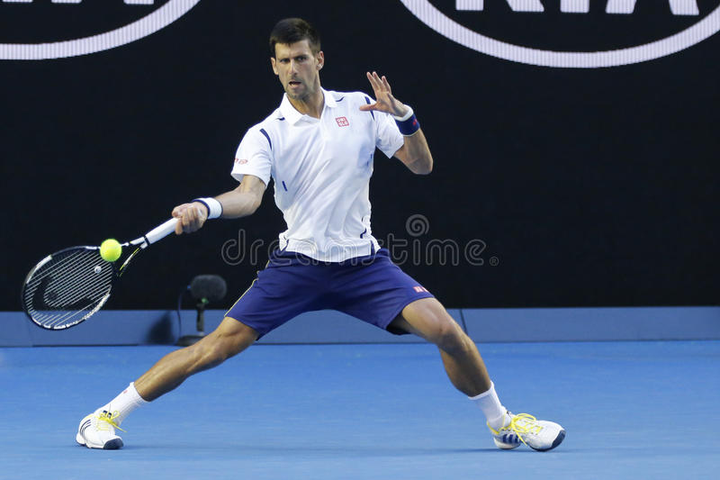 Eleven times Grand Slam champion Novak Djokovic of Serbia in action during his round 4 match at Australian Open 2016. MELBOURNE, AUSTRALIA - JANUARY 24, 2016 royalty free stock image