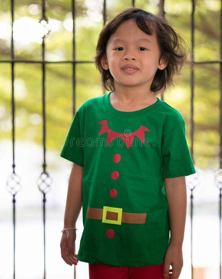 Elf boy help santaclaus in christmas send presents. Elf dress boy help santaclaus in christmas cerebration time send presents to children stock images