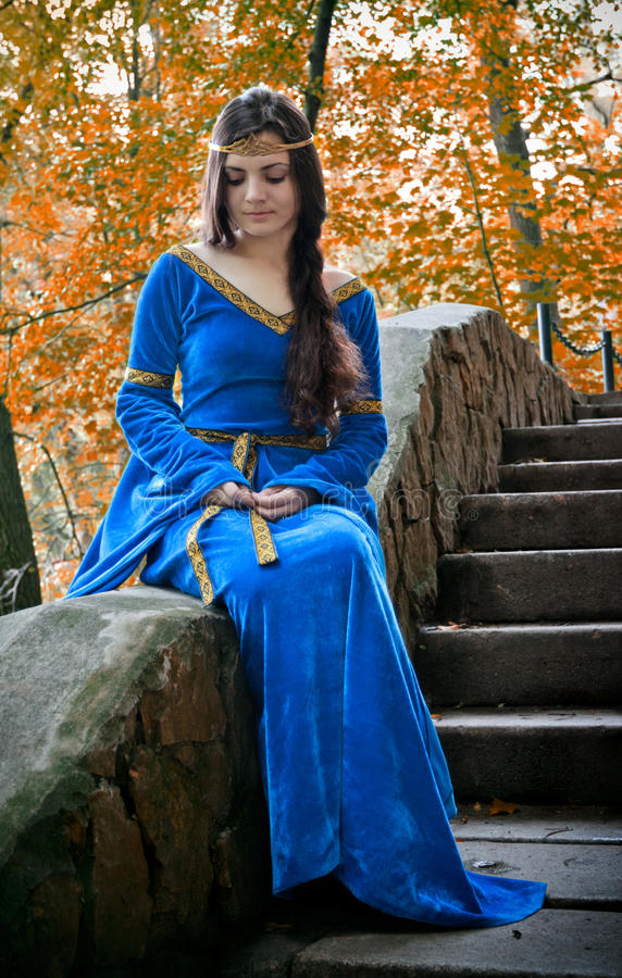 Elf princess on stone staircase. Beautiful elf princess sitting on stone staircase stock photo