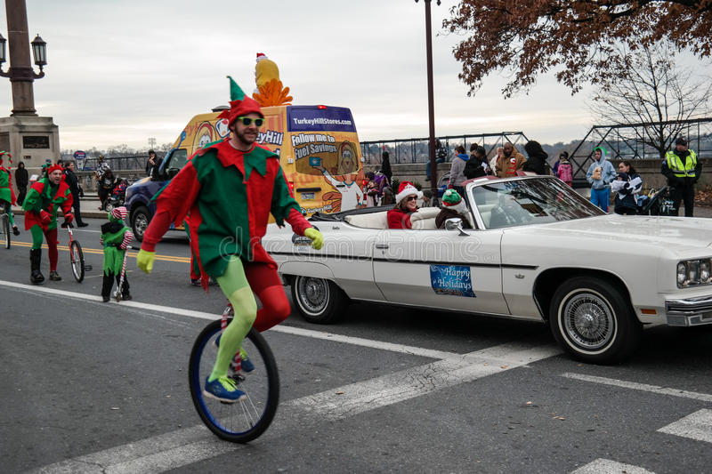 Elf on Unicycle. Harrisburg, PA, USA – November 22, 2014: A Christmas elf rides a unicycle in the Harrisburg Holiday Parade stock photography