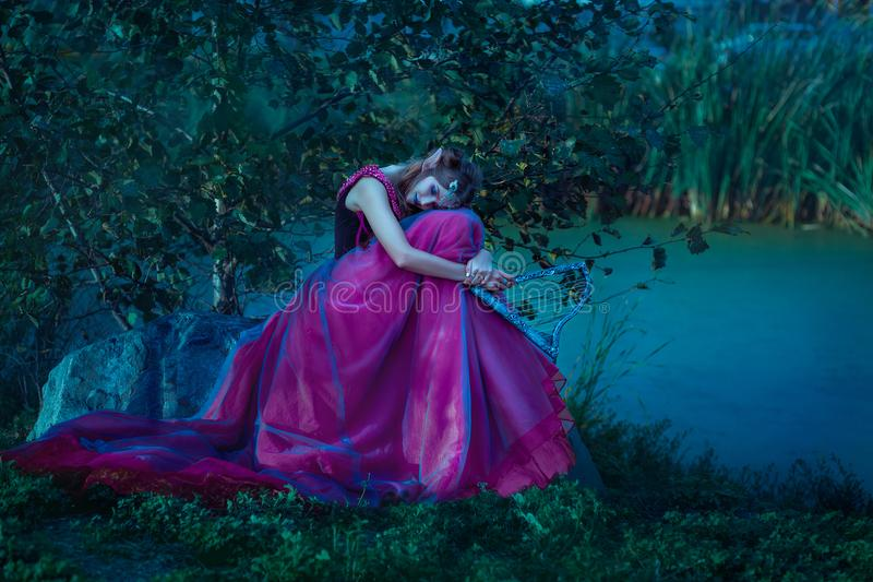 Elf woman in violet dress stock photos