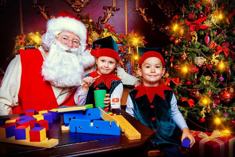 Elfi con Santa immagini stock