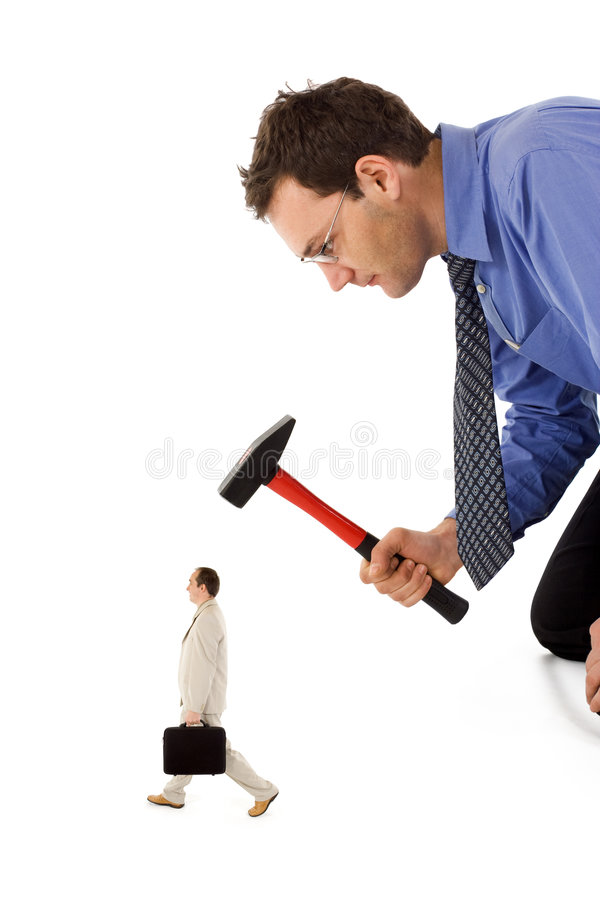 Eliminating a rival colleague. Businessman unfairly eliminating a small, rival colleague royalty free stock photos