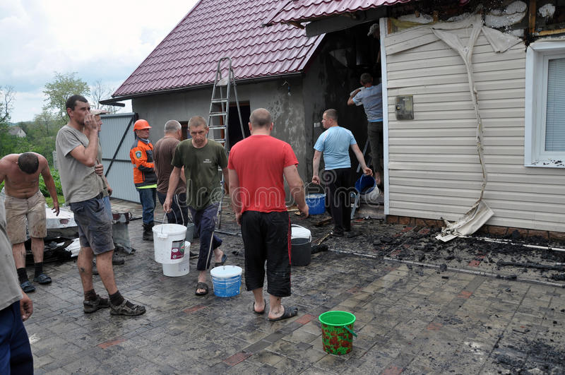 The elimination of a fire in a private rural residential building. NAHIRYANKA - CHORTKIV - Ukraine - May 31, 2016. The elimination of a fire in a private royalty free stock image