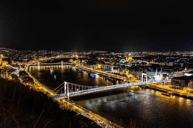 Elisabeth Bridge - Budapest - Hungary. Perfect night view of Elisabeth Bridge - Budapest - Hungary, photo taken from the Citadella Hill. On the background the royalty free stock images