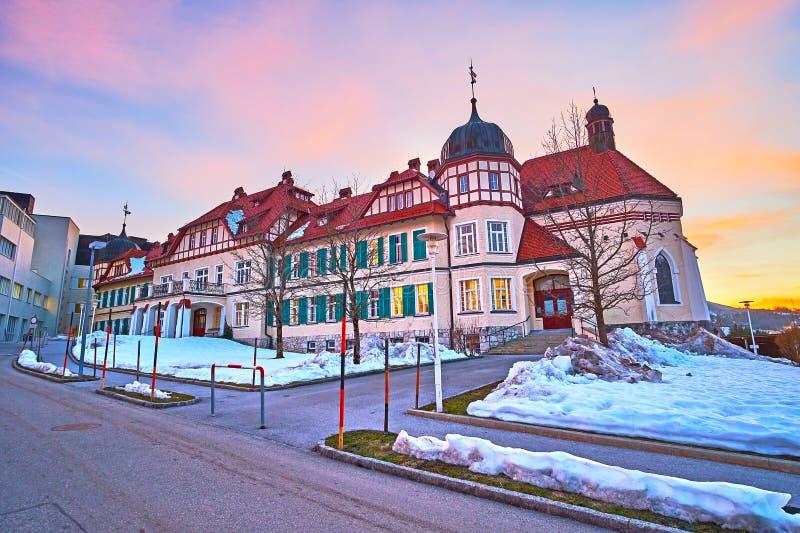 Elisabeth Hospital in Bad Ischl, Austria. Exterior of old Kaiserin Elisabeth Krankenhaus hospital on colorful winter sunset, Bad Ischl, Austria royalty free stock photos