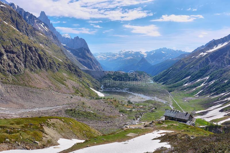 Elisabetta shelter and Peak of Aiguille Noire standing out in Veny valley, Aosta Valley, Italy. Peak of Aiguille Noire standing out in Veny valley, Aosta Valley royalty free stock photos