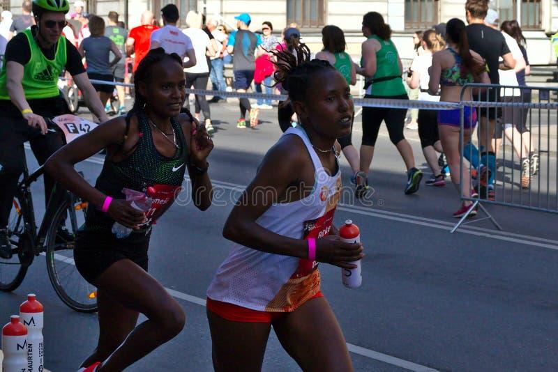 Riga, Latvia - May 19 2019: Elite female runners continuing the marathon stock images