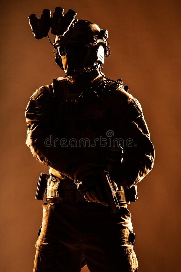 Elite forces soldier armed with service pistol stock photography