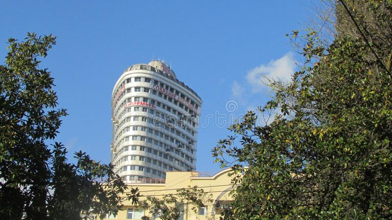 Elite new building in the resort town, on the facades of the offer for the sale of apartments. royalty free stock photos