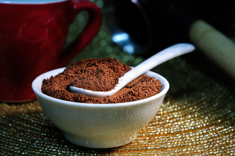 Elite powdered organic coffee. Close-up royalty free stock photo