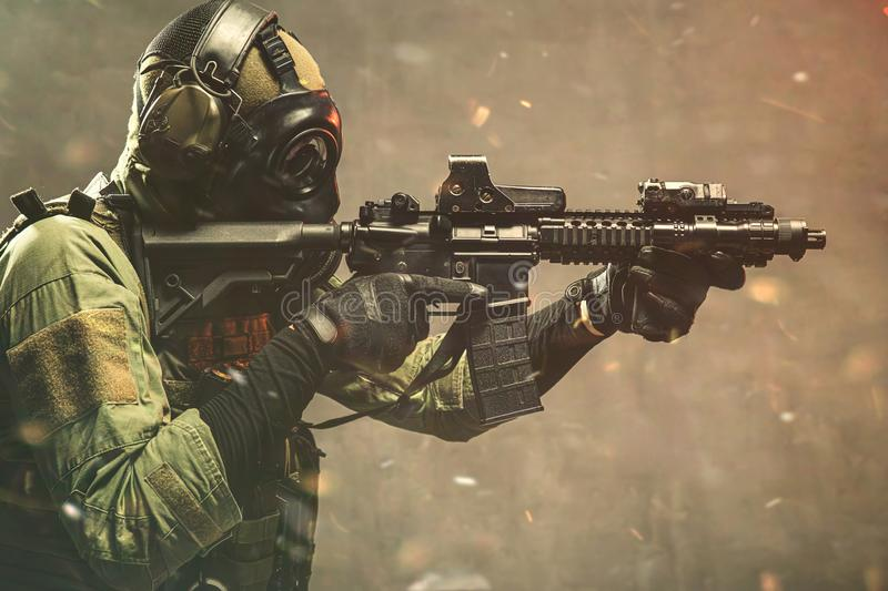 Elite special unit soldier with gasmask royalty free stock image